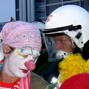 G8 demonstrators dressed as clowns